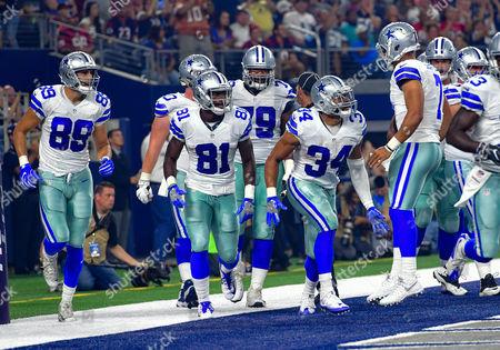 Dallas Cowboys running back Darius Jackson (34) celebrates with Dallas Cowboys quarterback Jameill Showers (7), Dallas Cowboys wide receiver Andy Jones (81) and Dallas Cowboys tight end Gavin Escobar (89) after running in for a touchdown