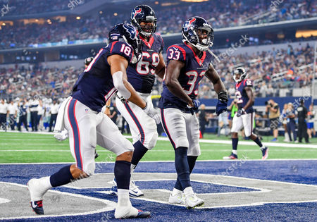 Houston Texans running back Akeem Hunt (33) celebrates with Houston Texans wide receiver Cecil Shorts (18) and Houston Texans offensive lineman Andrew McDonald (69) as he rushes in for a touchdown