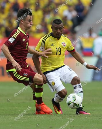 Colombia's Farid Diaz, right, fights for the ball with Venezuela's Juan Anor, left, during a 2018 World Cup qualifying soccer match in Barranquilla, Colombia