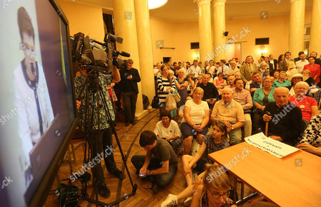Hanna Gronkiewicz-Waltz Representatives of left-wing organizations and groups of property owners and tenants watch broadcasts of Warsaw Mayor Hanna Gronkiewicz-Waltz during an extraordinary session of the Warsaw city council in Warsaw, Poland, on Thursday, Sept.1, 2016. The mayor said that irregularities in the restitution of seized Warsaw property to private owners were the fault of all political teams who have ruled the capital city under democracy since 1990, but stressed she was the one who successfully pushed for regulations that will take effect this month and will eliminate some of the bad practices
