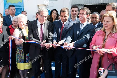 Stock Picture of Catherine Trautmann, Rolland Ries, Manuel Valls and Selma Elloumi Rekik cut the ribbon at the opening ceremony