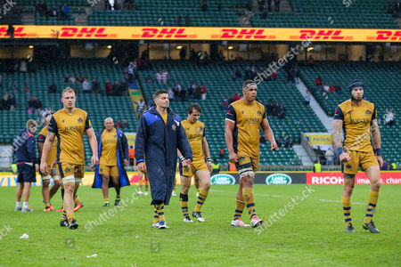 Mitch Eadie, Will Cliff, Ben Glynn and Ryan Edwards of Bristol Rugby look dejected after a narrow 21-19 loss to Harlequins