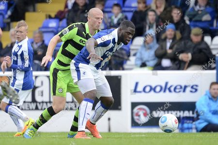 Forest Green Rovers defender Charlie Clough (5) holds up Chester striker James Alabi (9) 0-2 during the Vanarama National League match between Chester and Forest Green Rovers at the Deva Stadium, Chester
