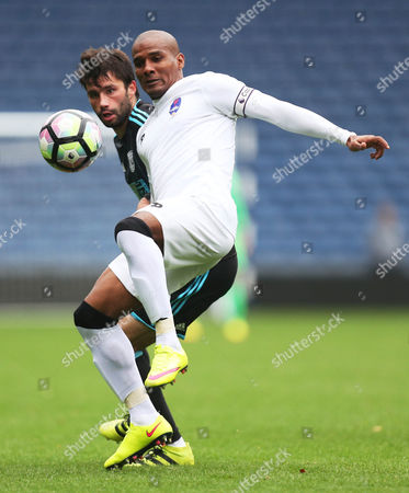 Florent Malouda of Delhi Dynamos and Claudio Yacob of West Bromwich Albion during the International friendly match between West Bromwich Albion and Delhi Dynamos played at The Hawthorns, West Bromwich on 3rd September 2016