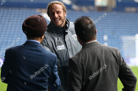 Jonas Olsson of West Bromwich Albion talks to guests pitchside before the International friendly match between West Bromwich Albion and Delhi Dynamos played at The Hawthorns, West Bromwich on 3rd September 2016