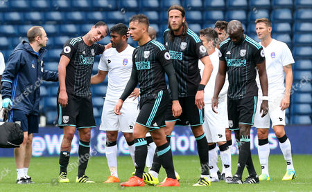 Marouane Chamakh of West Bromwich Albion is brought off injured during a trial with the club in the International friendly match between West Bromwich Albion and Delhi Dynamos played at The Hawthorns, West Bromwich on 3rd September 2016
