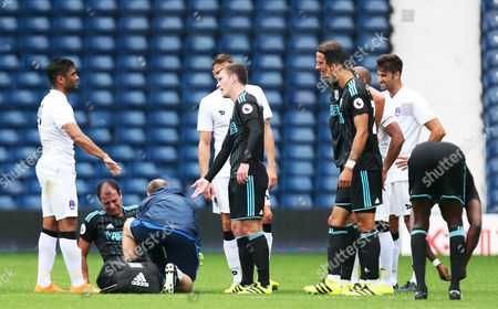 Stock Image of Marouane Chamakh of West Bromwich Albion is brought off injured during a trial with the club in the International friendly match between West Bromwich Albion and Delhi Dynamos played at The Hawthorns, West Bromwich on 3rd September 2016