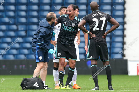 Stock Photo of Marouane Chamakh of West Bromwich Albion is brought off injured during a trial with the club in the International friendly match between West Bromwich Albion and Delhi Dynamos played at The Hawthorns, West Bromwich on 3rd September 2016