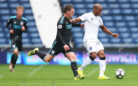 Craig Gardner of West Bromwich Albion and Florent Malouda of Delhi Dynamos during the International friendly match between West Bromwich Albion and Delhi Dynamos played at The Hawthorns, West Bromwich on 3rd September 2016