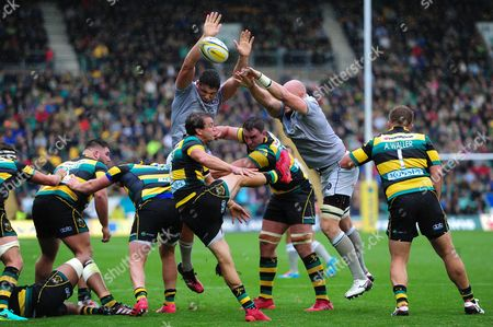 Lee Dickson of Northampton Saints box-kicks the ball
