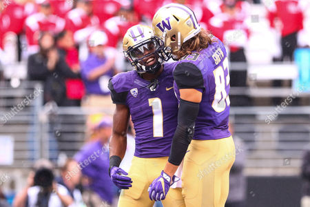 Washington's John Ross III (1) and Connor Griffin (83) celebrate after Ross' touchdown during the first half of a game between the Washington Huskies and Rutgers Scarlet Knights at Husky Stadium in Seattle, WA on , 2016