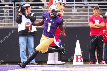 Washington's John Ross III (1) walks into the endzone for a touchdown during the first half of a game between the Washington Huskies and Rutgers Scarlet Knights at Husky Stadium in Seattle, WA on , 2016
