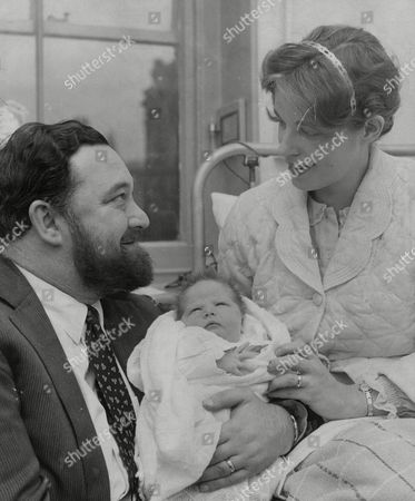 Stock Photo of Actor Michael Flanders And Wife Claudia With Their Newborn Daughter Laura Flanders At St Mary Abbot's Hospital Kensington. Box 704 904081639 A.jpg.