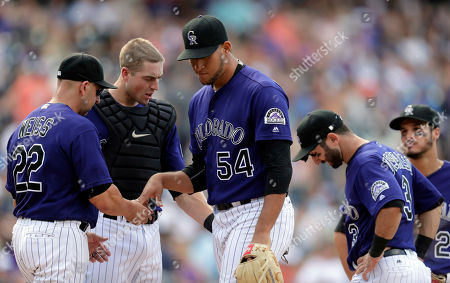 Walt Weiss, Carlos Estevez, Tom Murphy, Daniel Descalsco, Nolan Arenado Colorado Rockies manager Walt Weiss, left, takes the ball from relief pitcher Carlos Estevez, third from left, as catcher Tom Murphy, second from left, and shortstop Daniel Descalso and third baseman Nolan Arenado, right, look on in the eighth inning of a baseball game against the Arizona Diamondbacks, in Denver