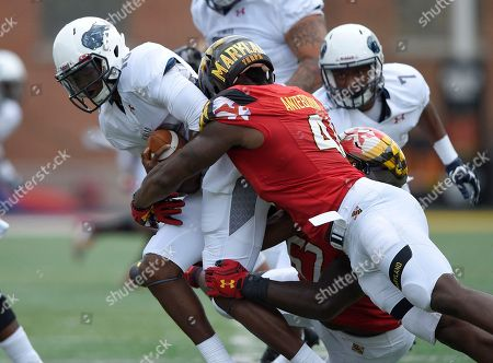 Jason Collins, Jesse Aniebonam Howard quarterback Jason Collins, left, is sacked by Maryland defensive lineman Jesse Aniebonam (41) and defensive lineman Kingsley Opara, back right, during the first half of an NCAA college football game, in College Park, Md