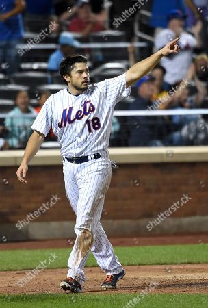 Travis d'Arnaud New York Mets Travis d'Arnaud points to the field after scoring on James Loney 's double in the sixth inning of a baseball game against the Washington Nationals, in New York