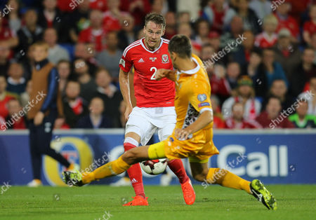 Chris Hunter of Wales sees his shot blocked by Igor Armas of Moldova