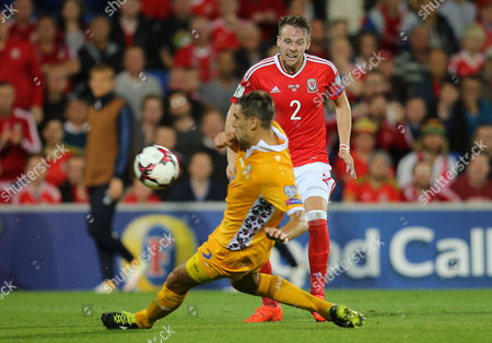 Stock Image of Chris Hunter of Wales sees his shot blocked by Igor Armas of Moldova