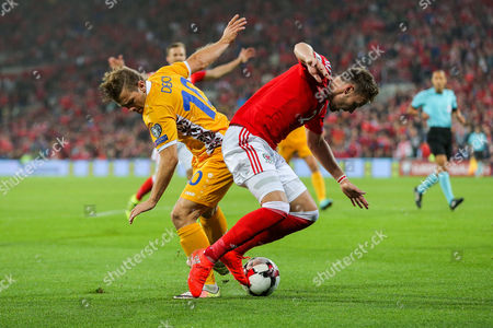 Stock Picture of Alexandru Dedov of Moldova and Chris Hunter of Wales compete for the ball