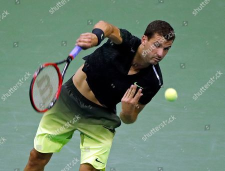 Stock Picture of Grigor Dimitrov, Andy Murray Grigor Dimitrov, of Bulgaria, serves to Andy Murray, of Britain, at the U.S. Open tennis tournament, in New York