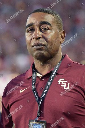 Former NFL wide receiver Cris Carter watches from the sideline before an NCAA college football game between Florida State and Mississippi in Orlando, Fla., . Florida State won 45-34