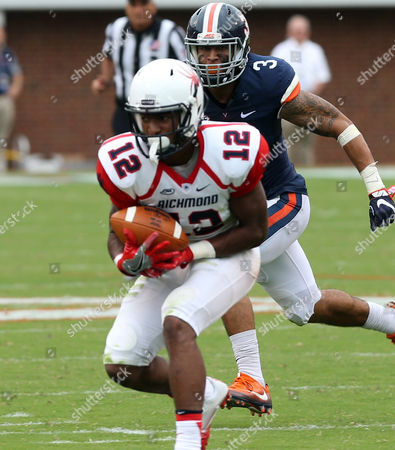 Richmond Virginia Basketball Richmond wide receiver Brian Brown (12) makes a catch in front of Virginia safety Kelvin Rainey (38) during the first half of an NCAA football game, in Charlottesville, Va