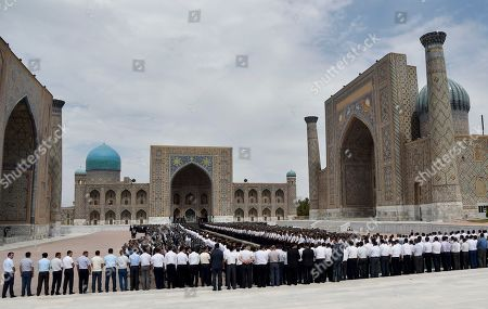 People gather to pay their last respect during the funeral of President Islam Karimov at the historic Registan Square in Samarkand, Uzbekistan, early . Karimov, whose harsh and ill-tempered rule governed Uzbekistan for a quarter-century, is to be buried in his home city of Samarkand