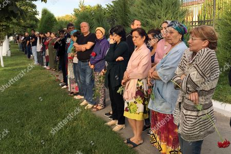 People gather along the road to watch the funeral procession of President Islam Karimov in Tashkent, Uzbekistan, early . Karimov has died of a stroke at age 78, the Uzbek government announced Friday