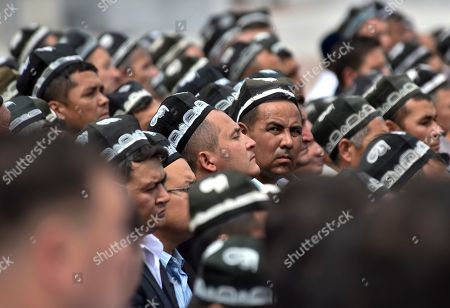 Uzbek men gather to pay their last respects, during the funeral of President Islam Karimov at the historic Registan Square in Samarkand, Uzbekistan, . ? Karimov, who crushed all opposition in the Central Asian country of Uzbekistan as its only president in a quarter-century of independence from the Soviet Union, has died of a stroke at age 78, the Uzbek government announced Friday