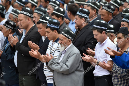 Uzbek men pray, as they pay their last respects, during the funeral of President Islam Karimov at the historic Registan Square in Samarkand, Uzbekistan, . ? Karimov, who crushed all opposition in the Central Asian country of Uzbekistan as its only president in a quarter-century of independence from the Soviet Union, has died of a stroke at age 78, the Uzbek government announced Friday