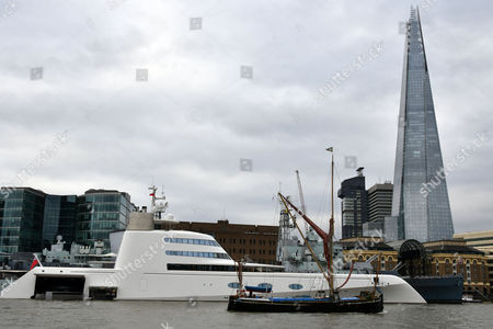 390ft Motor Yacht A, one of world's 25 largest superyachts, with 3 swimming pools plus luxurious cabins, owned by Russian tycoon Andrey Melnichenko, moored by Tower Bridge in London.