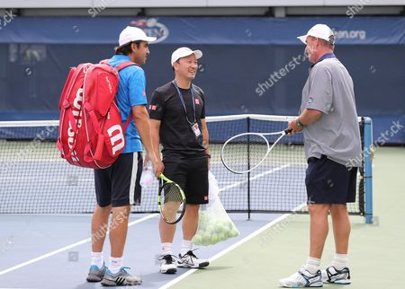 Ivan Lendl coach of Andy Murray Pictured talking  at his practice session with  Kai Nishikori coaches Dante Bottini left and Michael Chang  on the 6th September  at  the US Open Tennis Centre Flushing Meadows New York