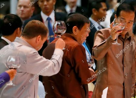 Dimitry Medvedev, Rodrigo Duterte, Joko Widodo From left, Russian Prime Minister Dimitry Medvedev, Philippine President Rodrigo Duterte and Indonesian President Joko Widodo make a toast during the gala dinner of ASEAN leaders and its Dialogue Partners in the ongoing 28th and 29th ASEAN Summits and other related summits at the National Convention Center in Vientiane, Laos