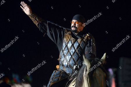On, U.S. actor Steven Seagal rides a horse during the opening ceremony of the second World Nomad Games at Issyk Kul lake in Cholpon-Ata, Kyrgyzstan. The Games, which opened on Saturday on a picturesque mountain plain in eastern Kyrgyzstan, bring together athletes from 40 countries including Russia and the United States where nomadic traditions are strong