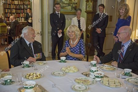Stock Photo of Camilla Duchess of Cornwall shares a joke with Squadron Leader Geoffrey Wellum (left)