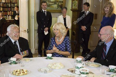 Camilla Duchess of Cornwall shares a joke with Squadron Leader Geoffrey Wellum (left)