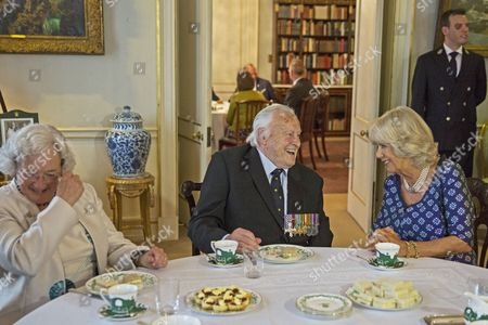 Camilla Duchess of Cornwall shares a joke with Squadron Leader Geoffrey Wellum