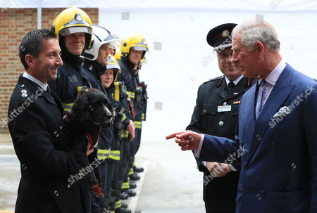 Prince Charles meets fire inspector Paul Osborne with fire investigation dog Sherlock