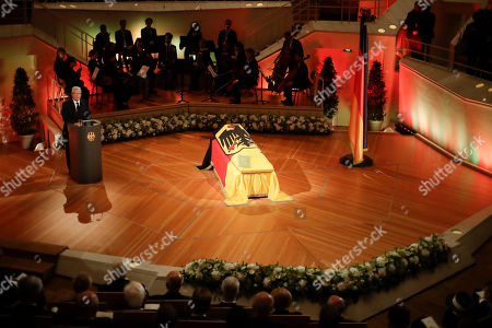 German President Joachim Gauck, left, delivers his speech near the coffin of former German President Walter Scheel during a state funeral service in Berlin, . Walter Scheel, who helped shape West Germany's policy of reconciliation with the communist bloc as foreign minister and later served as his country's president, died Aug. 24, 2016. He was 97