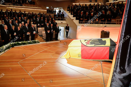 German President Joachim Gauck, left, and German Chancellor Angela Merkel, second from left, pay tribute in front of the coffin of former German President Walter Scheel during a state funeral service in Berlin, . Walter Scheel, who helped shape West Germany's policy of reconciliation with the communist bloc as foreign minister and later served as his country's president, has died. Aug. 24, 2016. He was 97