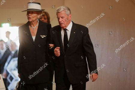 German President Joachim Gauck, right, arrives with Barbara Scheel, the widow of former German President Walter Scheel during a state funeral service for the former President in Berlin, . Walter Scheel, who helped shape West Germany's policy of reconciliation with the communist bloc as foreign minister and later served as his country's president, died Aug. 24, 2016. He was 97