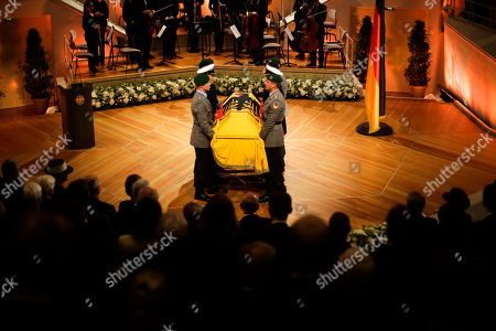 Honor guards carry the coffin of former German President Walter Scheel during the state funeral service in Berlin