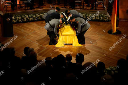 Honor guards lift the coffin of former German President Walter Scheel during the state funeral service in Berlin, . Walter Scheel, who helped shape West Germany's policy of reconciliation with the communist bloc as foreign minister and later served as his country's president, died Aug. 24, 2016. He was 97