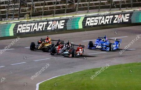 James Hinchcliffe, Graham Rahal, Tony Kanaan Graham Rahal, center, passes James Hinchcliffe, left, in Turn 4 as the two lead Tony Kanaan, of Brazil, into the front stretch on the final lap of the IndyCar auto race at Texas Motor Speedway, in Fort Worth, Texas. Rahal won the race