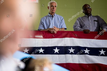 Charlie Crist Former Republican Florida Gov. Charlie Crist, left, stands on a balcony and listens as Democratic presidential candidate Hillary Clinton speaks at a rally at University of South Florida in Tampa