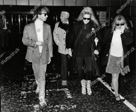 Robin Gibb Of The Bee Gees Pop Group At Heathrow Airport To Meet His Father Hugh (in Background) And A Family Friend From Los Angeles. Box 706 503081645 A.jpg.