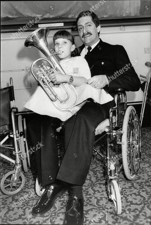 Child Of Achievement Awards. Pc John (jon) Gordon Who Lost Both Legs In The Ira Bombing Of Harrods Last Year With 10-year-old Nicolette Erevik Severely Handicapped And Confined To A Wheelchair With Her Tenor Horn. Box 706 30308169 A.jpg.