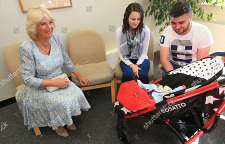 Camilla Duchess of Cornwall (left), meets 6 month old Noah Jay and his parents Sarah Saville and Tom Jay