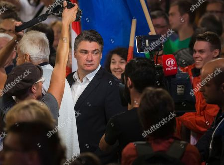 Zoran Milanovic Late, leader of the center-left coalition Zoran Milanovic arrives at a rally in Zagreb, Croatia. Croats go to the polls this weekend in a snap election that, despite the country's many problems, has been more about past divisions than future challenges facing the European Union's newest member state