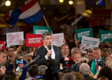 Zoran Milanovic Late, leader of the center-left coalition Zoran Milanovic talks to supporters at a rally in Zagreb, Croatia. Croats go to the polls this weekend in a snap election that, despite the country's many problems, has been more about past divisions than future challenges facing the European Union's newest member state